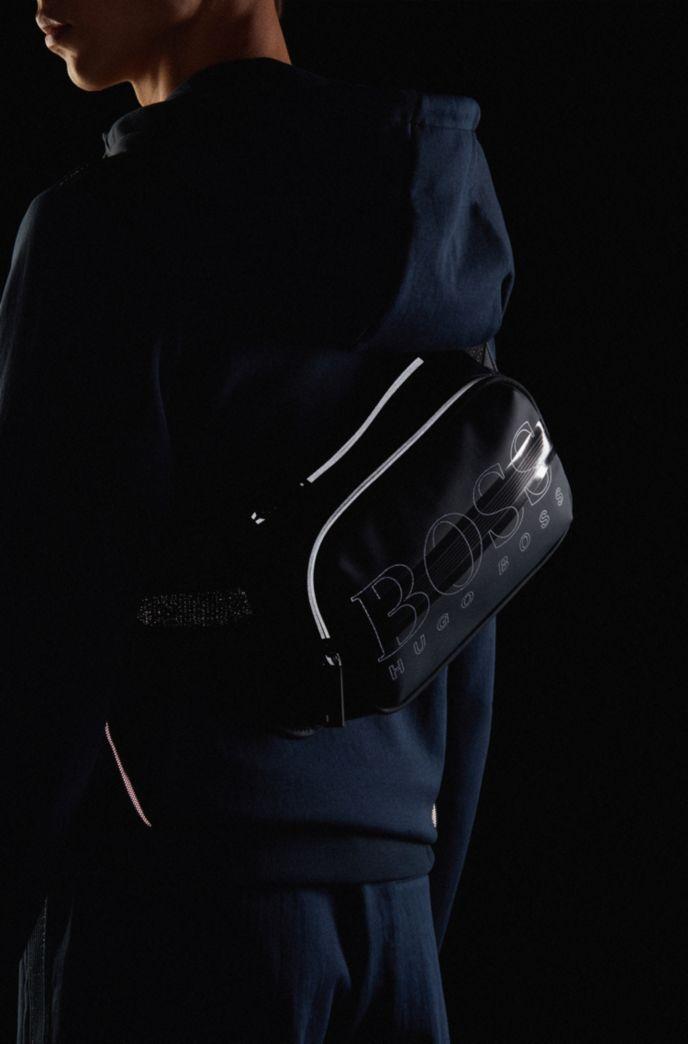 Adjustable belt bag with logo and reflective elements