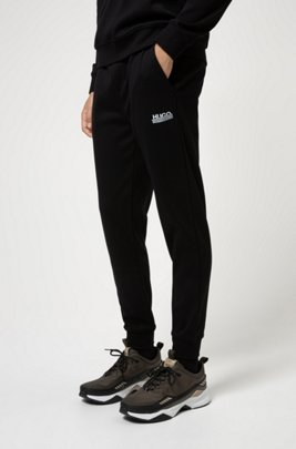 Cuffed jogging trousers in cotton with new-season logo, Black
