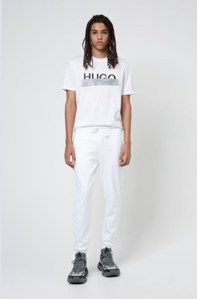 Cuffed jogging trousers in cotton with new-season logo