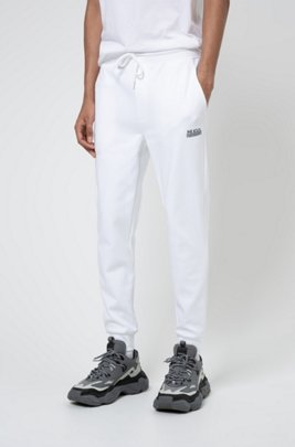 Cuffed jogging trousers in cotton with new-season logo, White