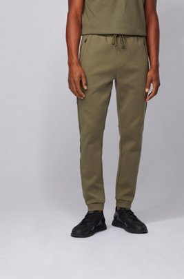 Slim-fit jogging trousers with reflective details, Dark Green