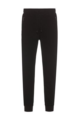 Cotton-blend French terry jogging trousers with zipped pockets, Black