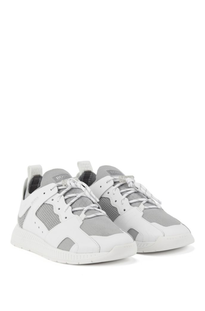Leather-trimmed trainers with reflective knit