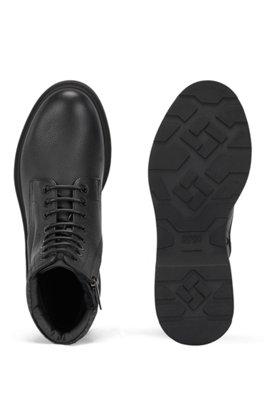 In Italië gemaakte laarzen van generfd leer met monogramkraag, Zwart