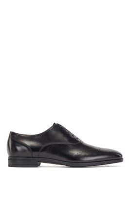 Oxford shoes in burnished leather with lasered details, Black