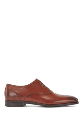Oxford shoes in burnished leather with lasered details, Brown