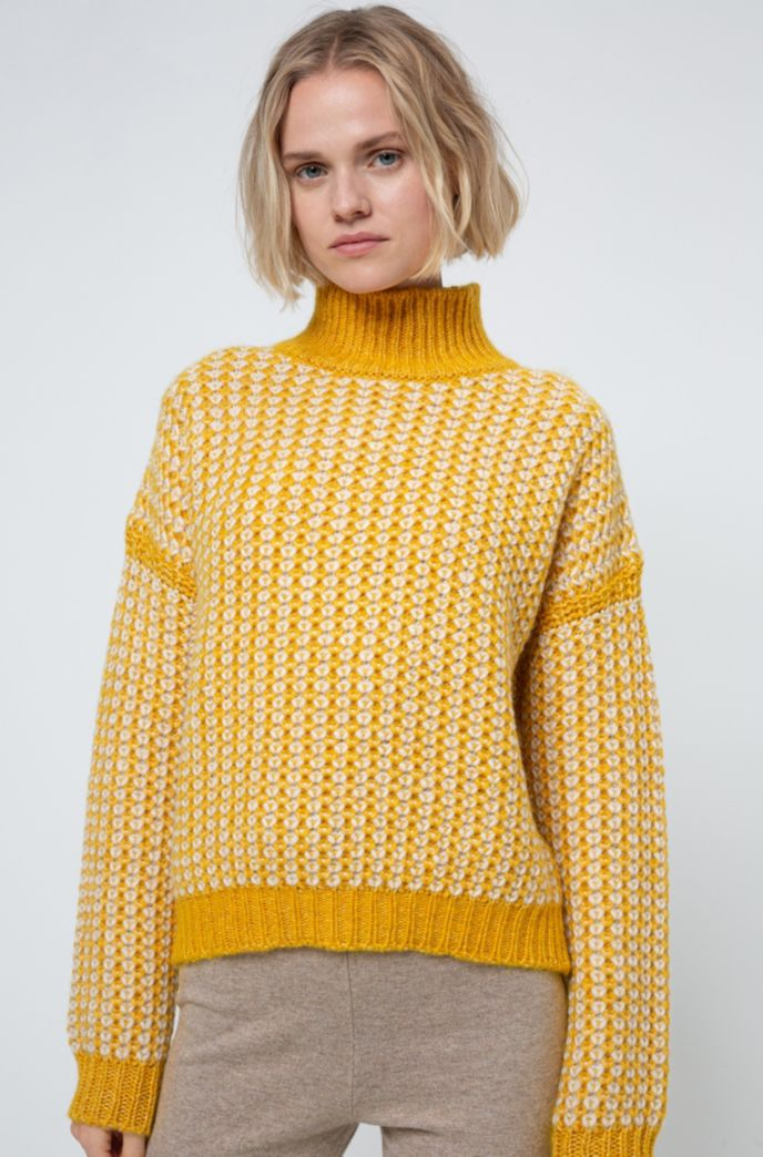 Rollneck sweater with two-tone knitted structure