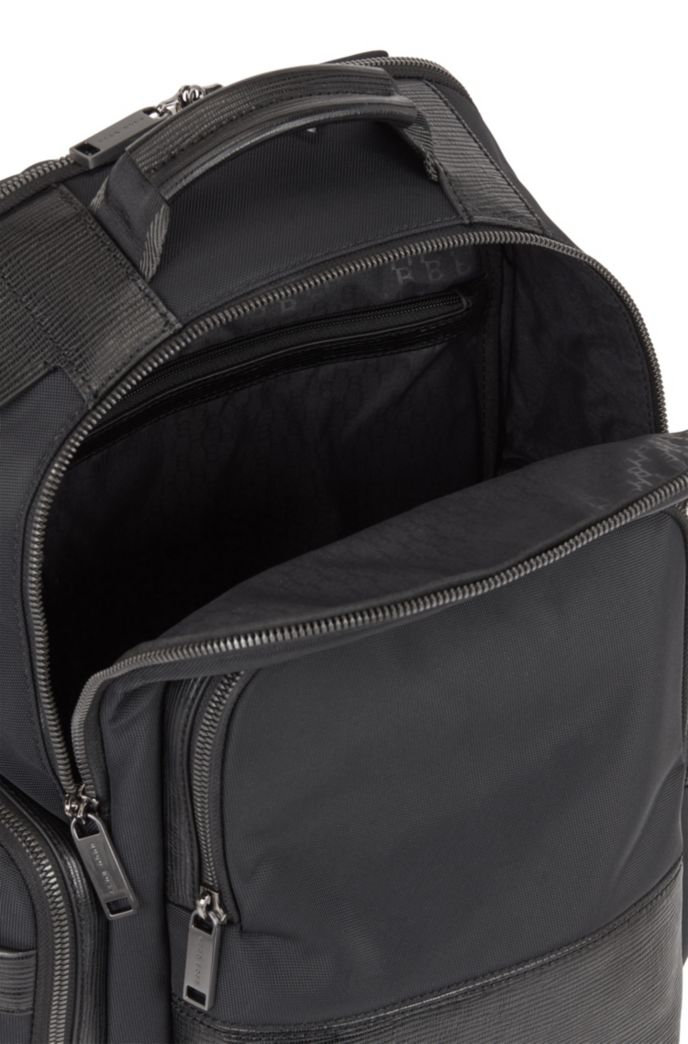 Multi-pocket backpack with monogram address tag