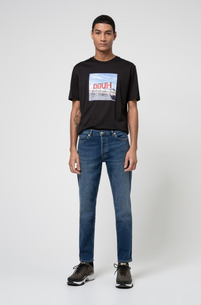 Tapered-fit jeans in mid-blue stretch denim