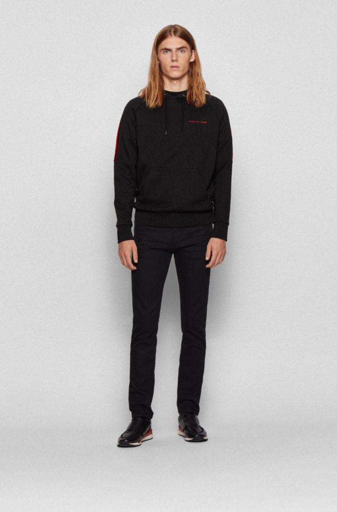 Tapered-fit jeans in black-black Italian denim