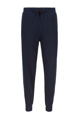 Pantalon en jersey suédé avec imprimé logo placé, Bleu foncé