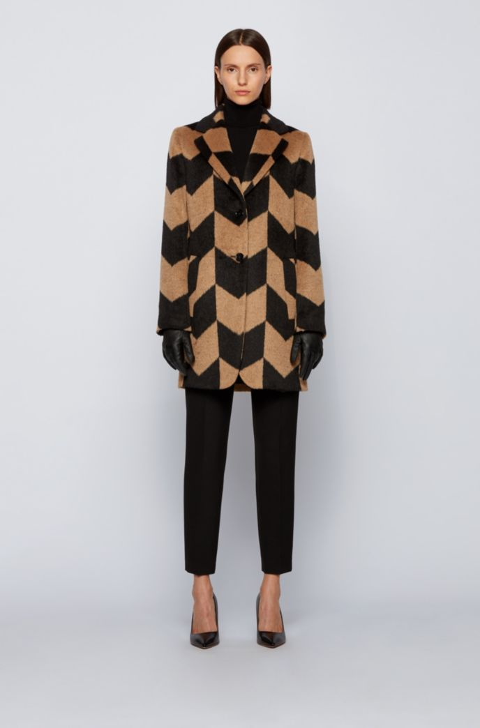 Relaxed-fit coat in textured fabric with chevron pattern
