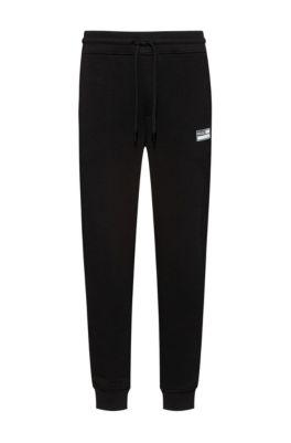 Pantalon de survêtement en polaire de coton mélangé éco-responsable resserré au bas des jambes, Noir