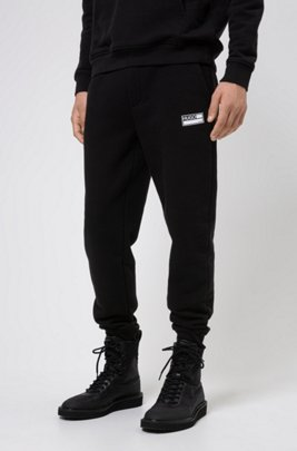 Cuffed-hem jogging trousers in responsible cotton-blend fleece, Black