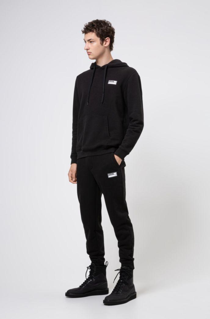 Cotton-blend fleece hoodie with manifesto graphics
