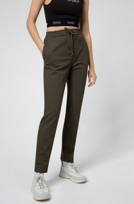 Regular-Fit Hose aus Stretch-Gewebe mit Logo-Tape am Tunnelzugbund, Khaki