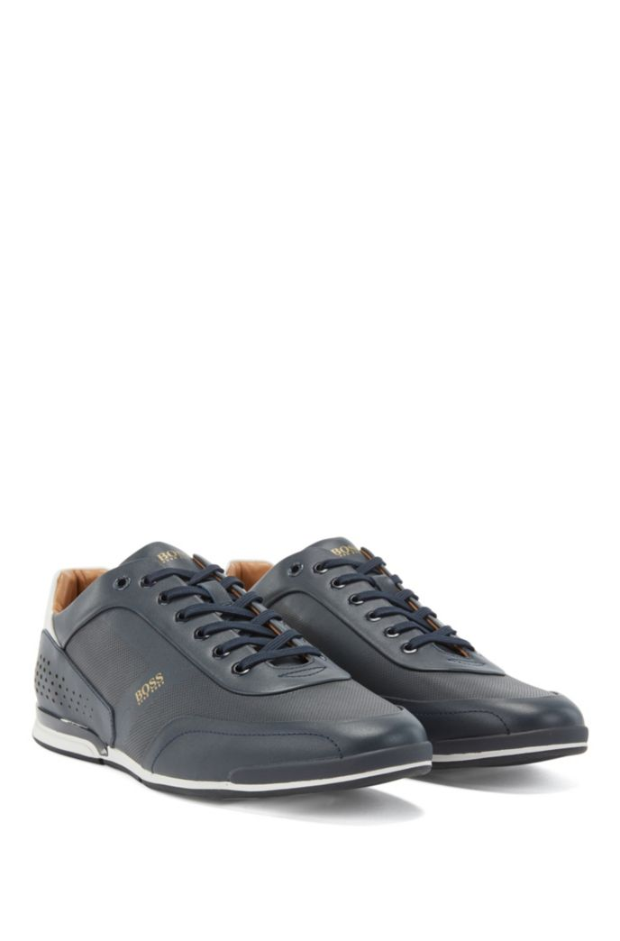 Low-top trainers in nappa leather with lasered perforations