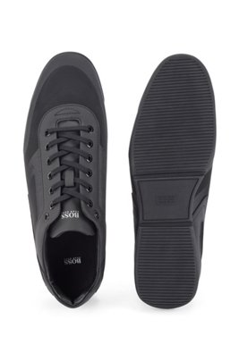 Low-top trainers in mixed materials with logo details, Black