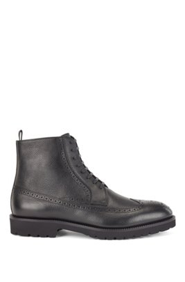Lace-up boots in calf leather with brogue details, Black