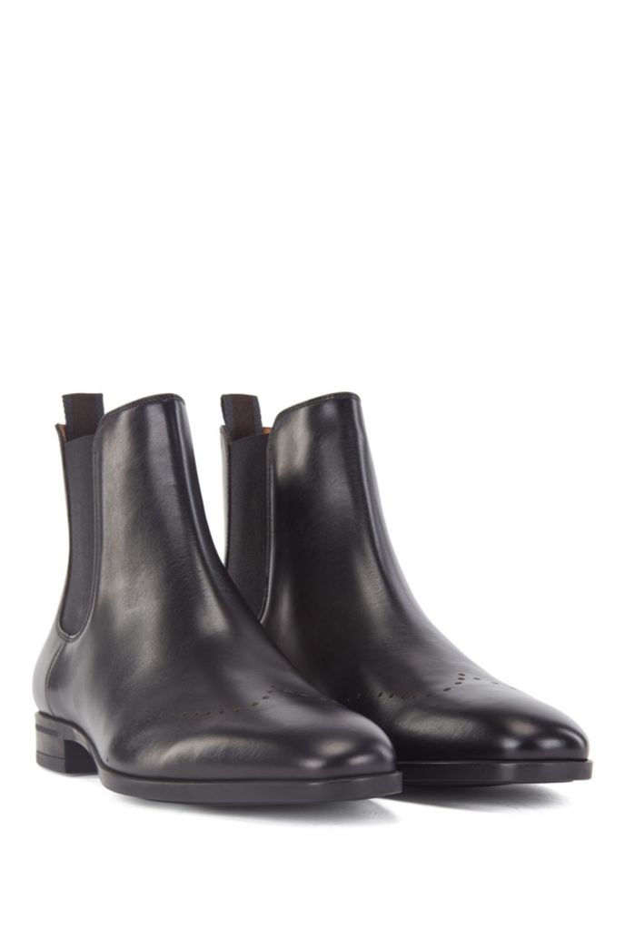 Chelsea boots in burnished leather with lasered details