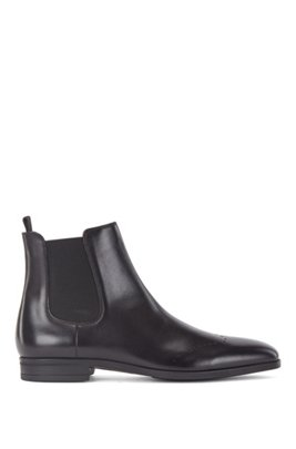 Chelsea boots in burnished leather with lasered details, Black