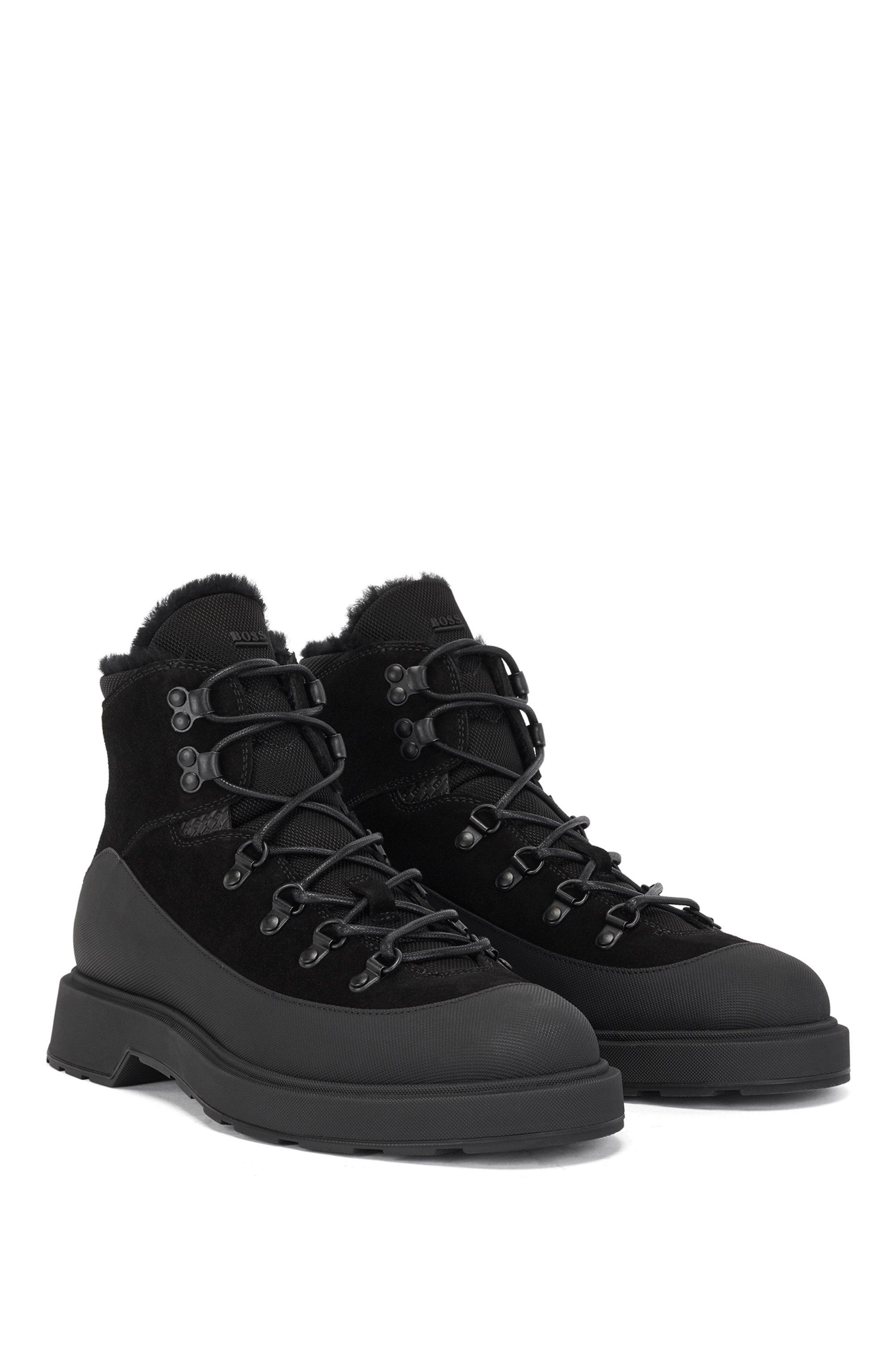 Boots inspirées des chaussures de randonnée, en cuir mélangé