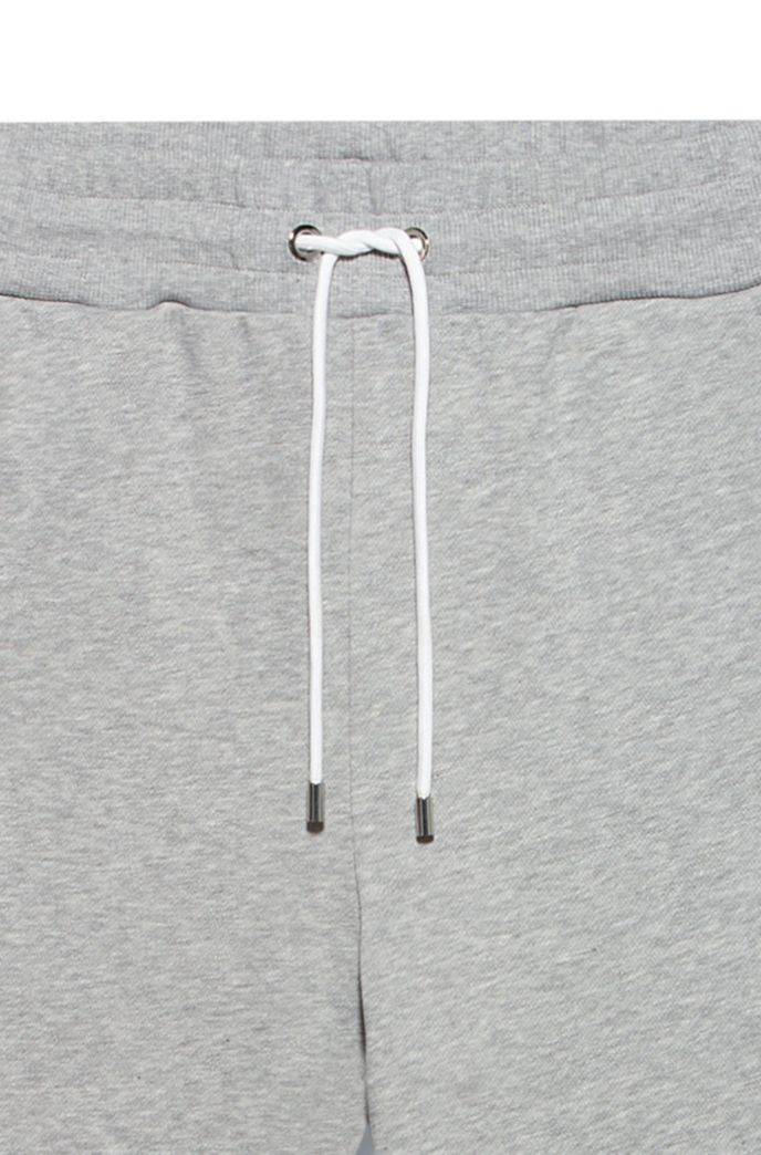 Regular-fit trousers in French terry with zipped hems