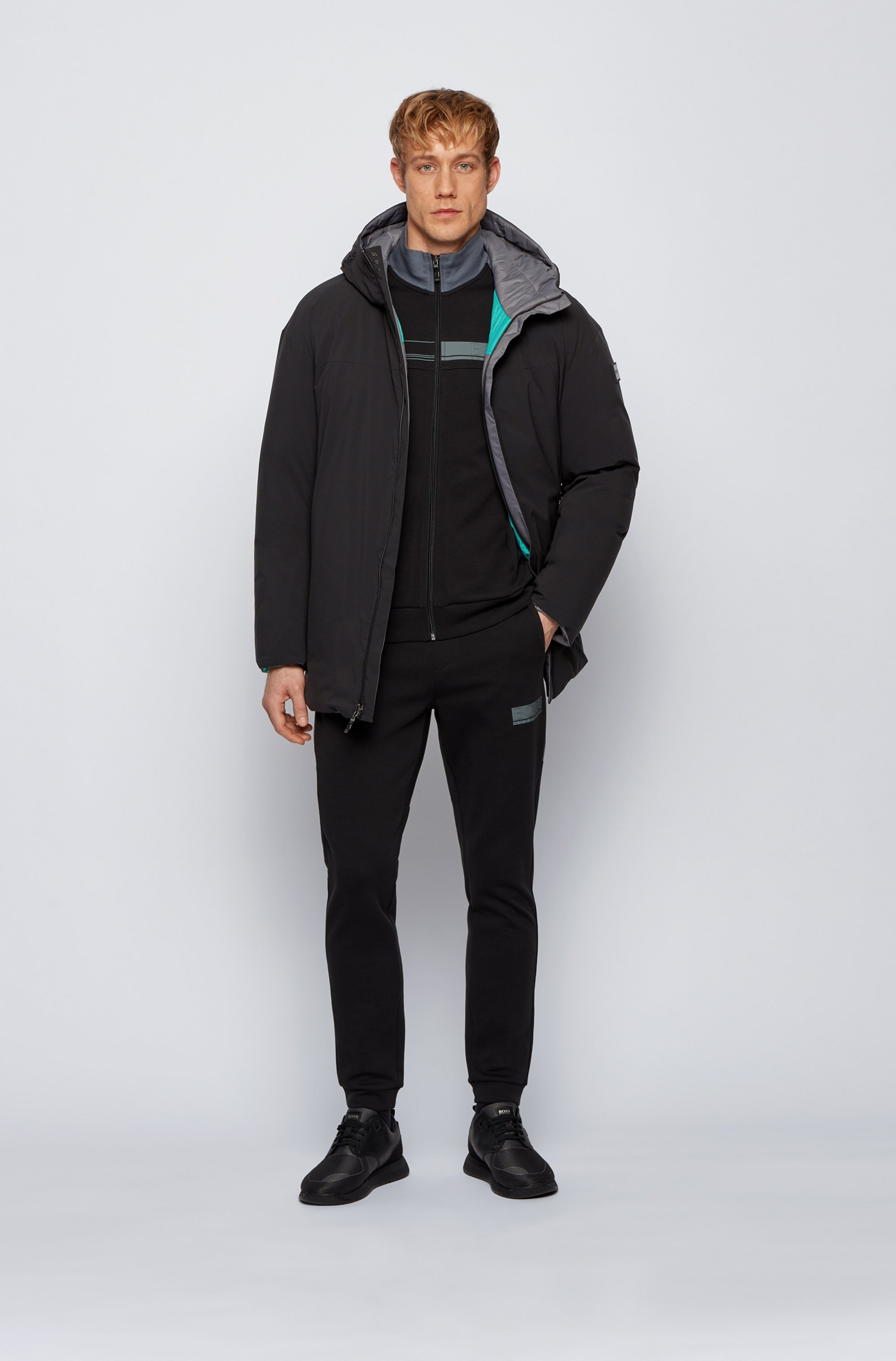 Reversible oversized down jacket in water-repellent fabric