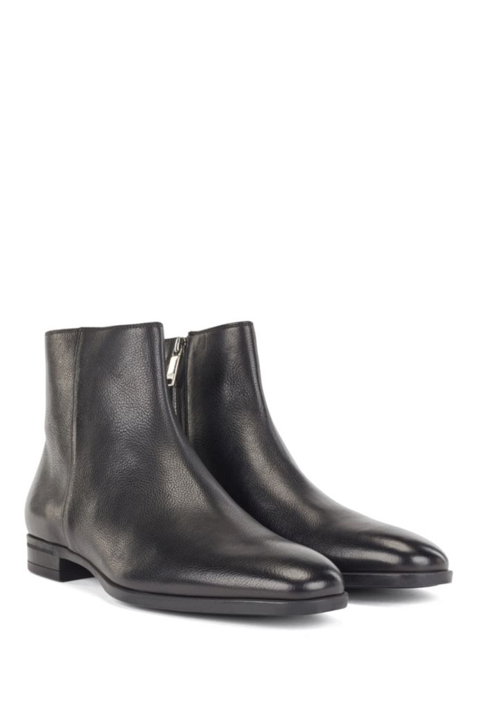 Zipped ankle boots in vegetable-tanned leather