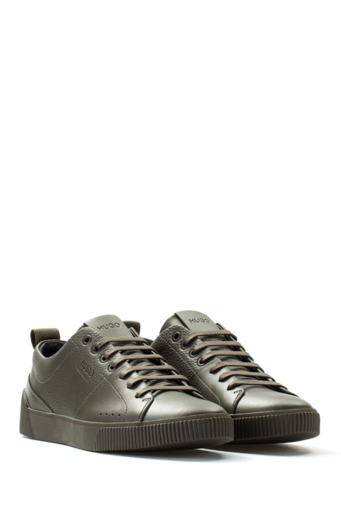 Tennis-style trainers in smooth and grainy leather