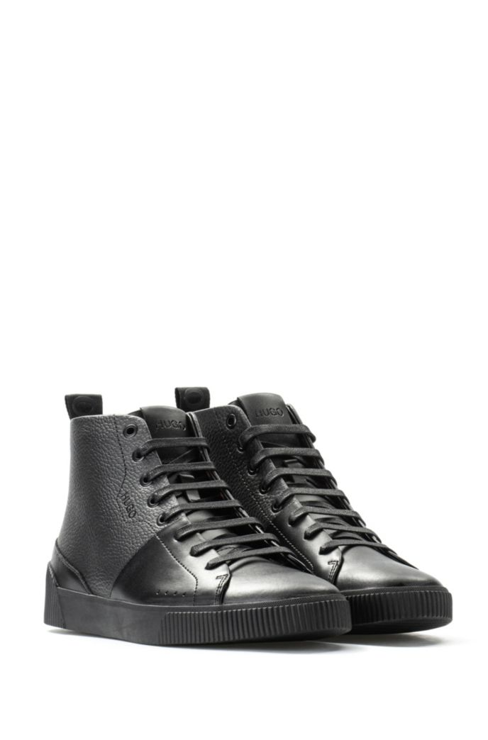 High-top trainers in smooth and grainy leather