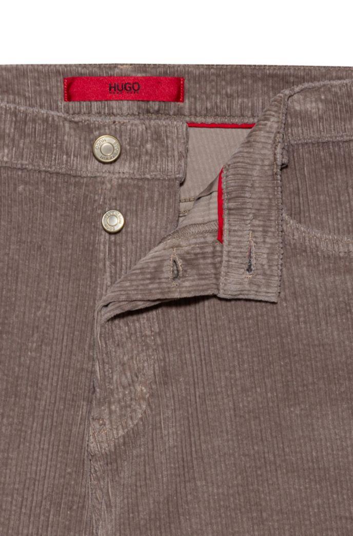 Jeans con fit affusolato in velluto a coste di cotone elasticizzato sovratinto