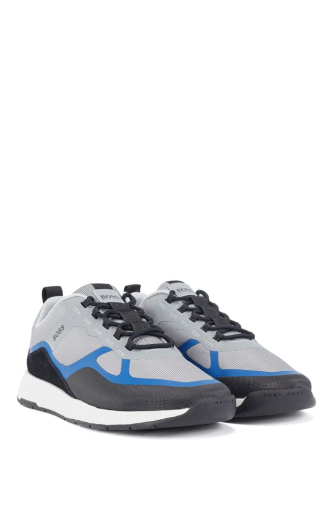 Hybride sneakers met suède overlays