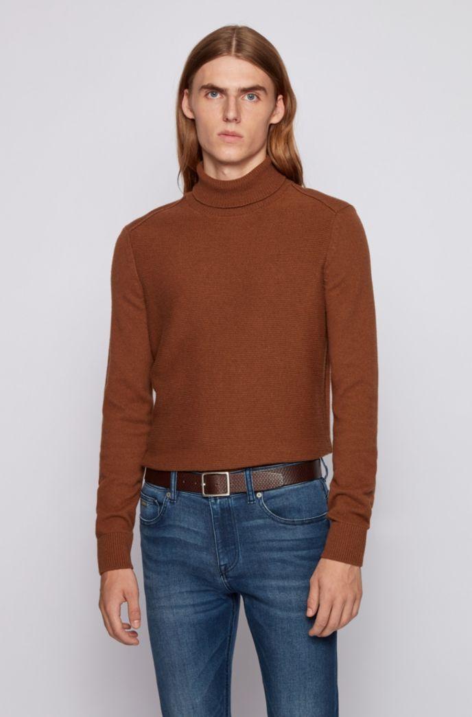Monogram-embossed belt in tanned Italian leather