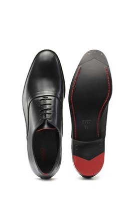 Oxford shoes in polished leather with signature details, Black