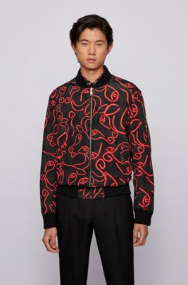 Reversible jacket with lustrous and ox-head-print sides, Red Patterned