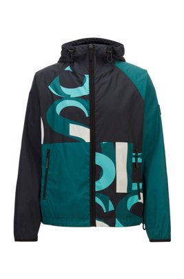 Water-repellent reversible jacket with stars and logos, Turquoise