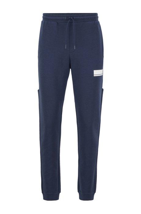 Slim-fit trainingsbroek met contraststrepen, Donkerblauw