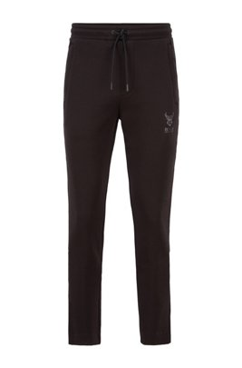 Piqué-knit tracksuit bottoms with ox-head artwork, Black