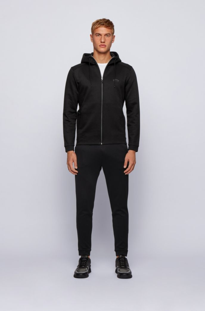 Double-faced cotton-blend tracksuit bottoms with curved logo