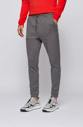 Double-faced cotton-blend tracksuit bottoms with curved logo, Grey
