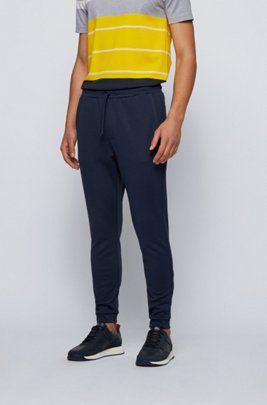 Double-faced cotton-blend tracksuit bottoms with curved logo, Dark Blue