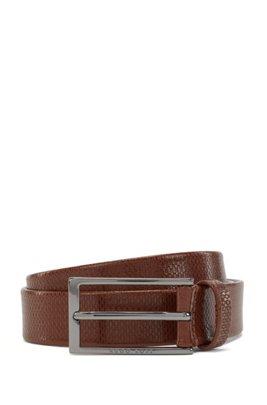 Monogram-embossed belt in vegetable-tanned leather, Brown