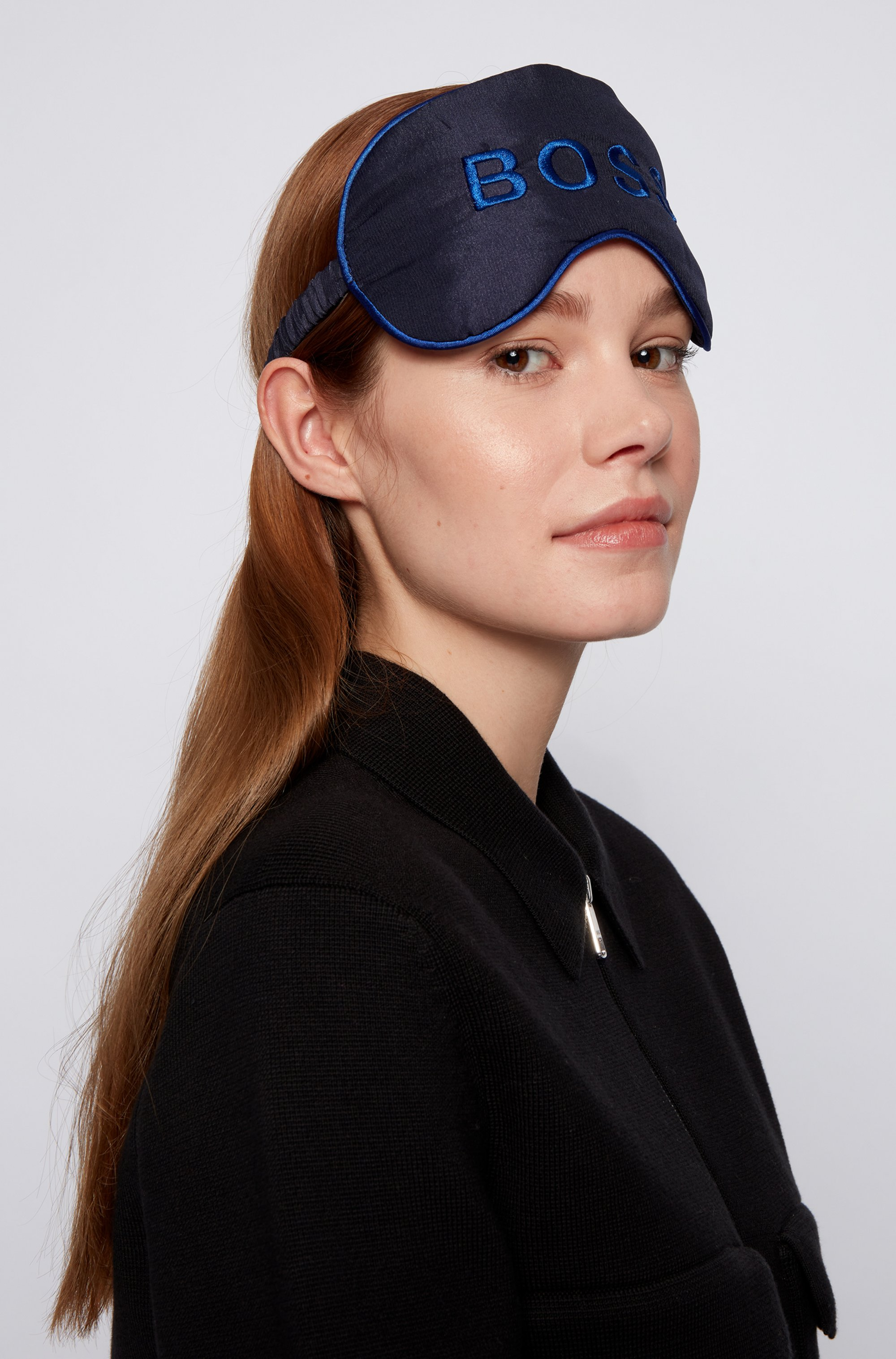 Eye mask with embroidered logo and travel pouch