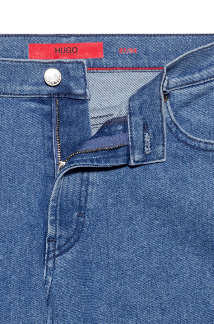 Straight-fit jeans in stretch denim with logo-tape turn-ups