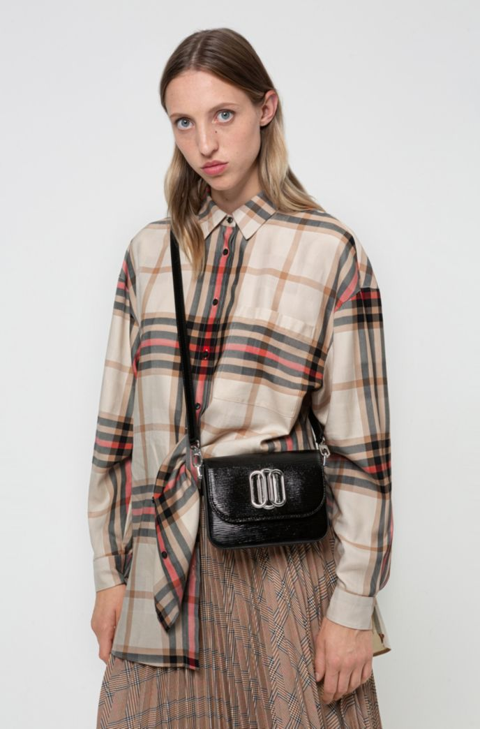 Cross-body bag in patent leather with signature hardware