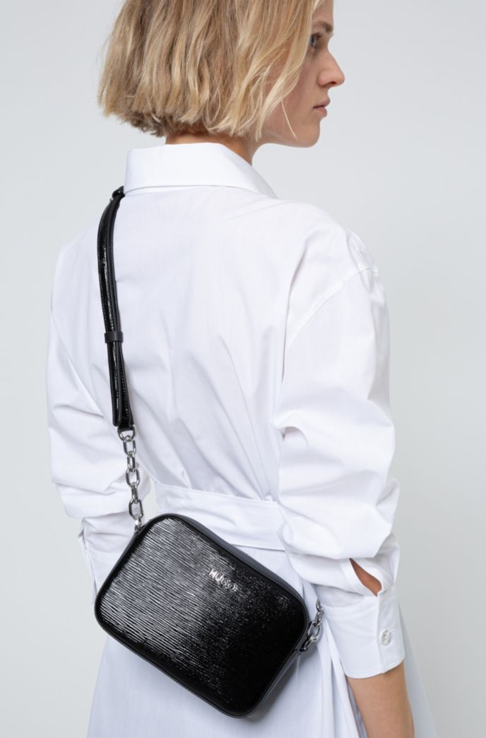 Cross-body bag in patent leather with logo lettering