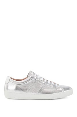 Low-top trainers in metallic leather with monogram detailing, Silver