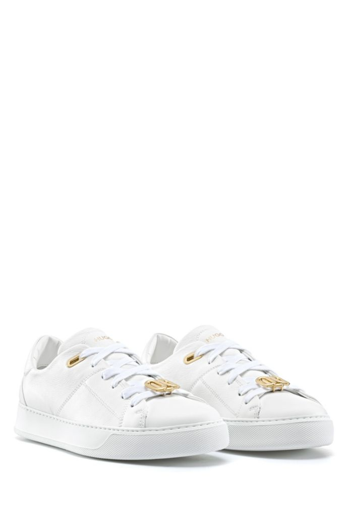 Low-top trainers in Italian leather with signature hardware