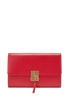 Monogram-clasp crossbody bag in structured leather, Red
